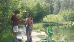 Dre teaching the kids to fish